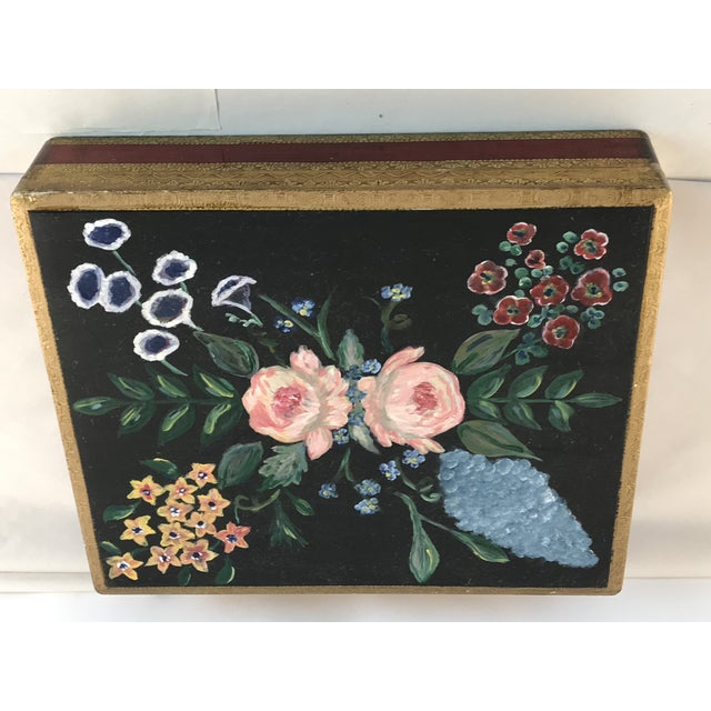 Charming Flornce Italy gold leafed hinged lidded box. Charming florals are hand painted on the front with gray/black...