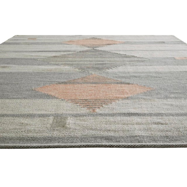 A modern take on traditional Southwestern style, this unique flatweave area rug boasts a striking geometric pattern. Chic...