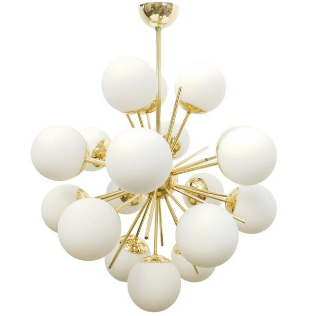 Italian chandelier shown in 18 matte white Murano glass globes mounted on polished brass frame, designed by Fabio Bergomi...