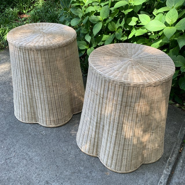 """Pair of round top draped rattan table, natural finish. Top diameter 22"""". Natural rattan table with metal core structure...."""