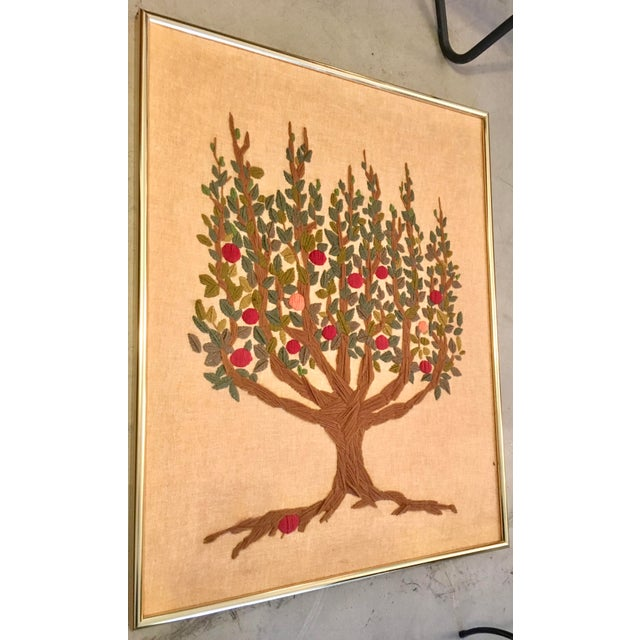 Great vintage tapestry of the tree of life done in different colors of yarn. The frame is aluminum gold.