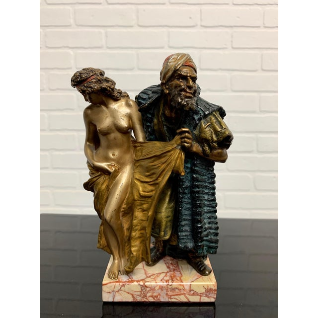 Cold painted orientalist Vienna bronze of a middle eastern man with a women by Franz Bergman. On the back of her robe is...