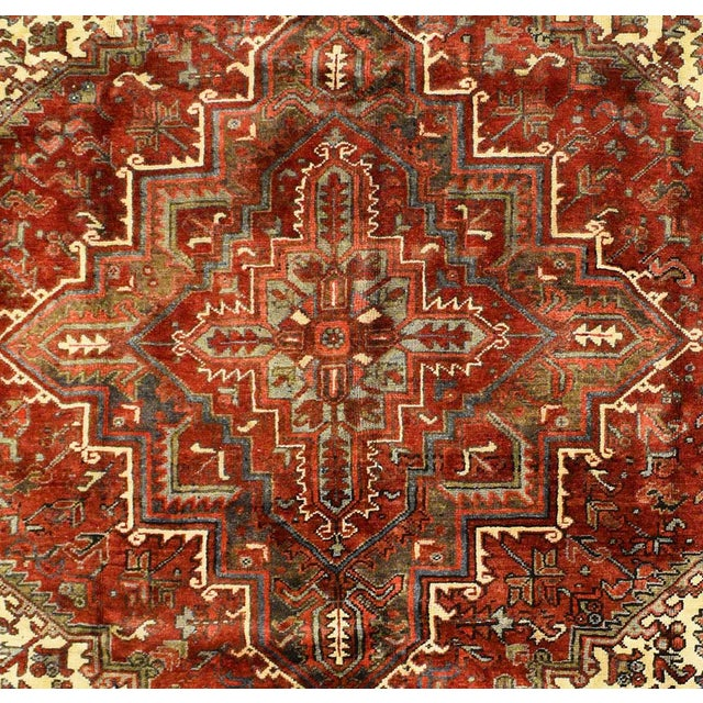 This beautiful rug is hand made, made in Iran. It features a pattern in a vibrant combination of red, green,blue, white....