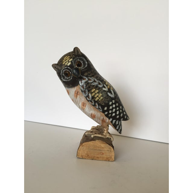This distinguished vintage owl is perched on a branch, and grips it with very lifelike feet. He is beautifully hand...