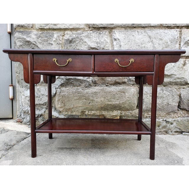 Beautiful Asian rosewood console table with 2 drawers and brass pulls.This piece is very versatile and can be used as a...