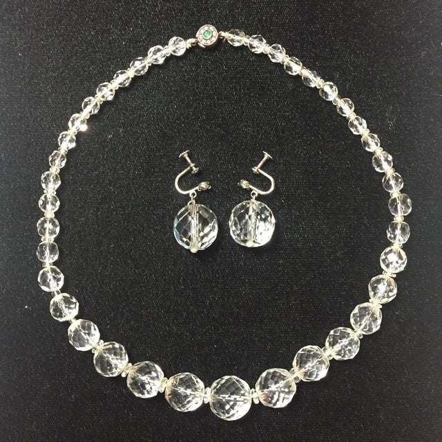 Offered here is an Edwardian cut lead crystal necklace and coordinating crystal & sterling screw-back earrings from the...