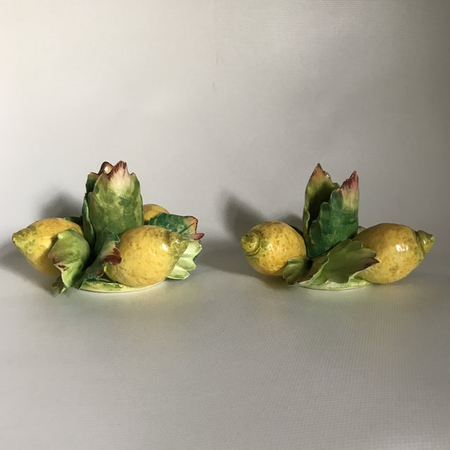 Pair of delicate hand painted porcelain candle holders with lemons and greenery. Made in Italy.