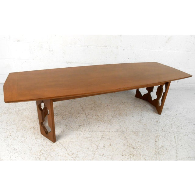 This wonderful mixture of clean mid-century design with unique sculptural style base adds a unique table to any seating...