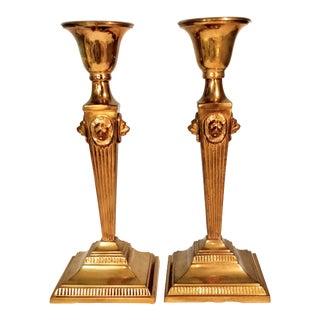20th Century Art Deco Brass Lion Candlesticks - a Pair