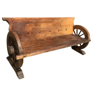 Antique Wheel and Iron Nail Rustic Bench For Sale