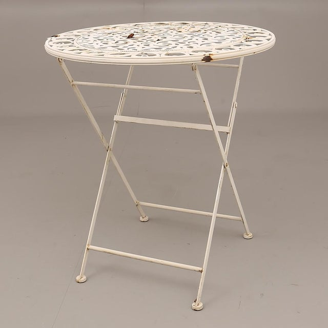 Cast metal painted folding chairs and table made in Sweden in the 1960s. Dimensions H 37.01 in. x W 27.17 in. x D 27.17...