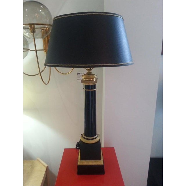 This chic and stylish French Empire style table lamp is attributed to Maison Jansen and was acquired from a Palm Beach...