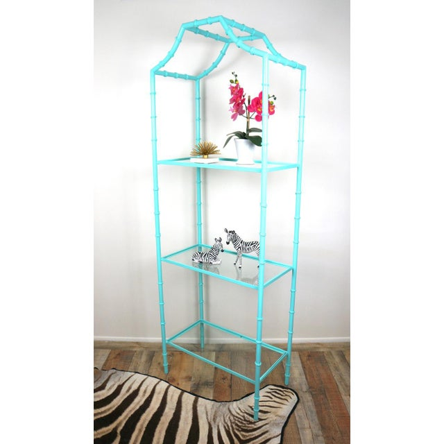 Hollywood Regency style etagere shelf. Made of metal with faux bamboo design. 3 clear glass shelves. Painted turquoise...