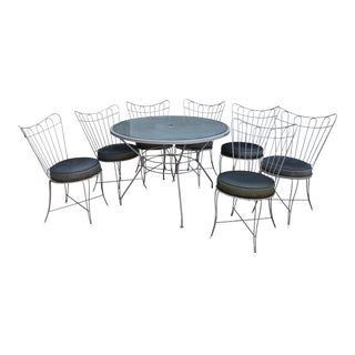 Wrought Iron Patio Table and 7 Matching Chairs For Sale