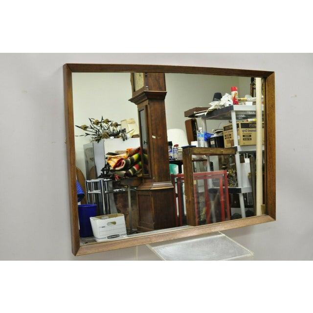 Vintage Mid Century Modernist Walnut Rectangular Wall Dresser Deep Frame Mirror. Item features thick solid wood frame,...
