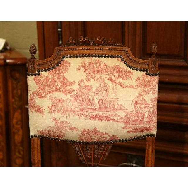 This elegant fruit wood armchair was crafted in France circa 1860. The chauffeuse chair, known as a fireside chair, is a...