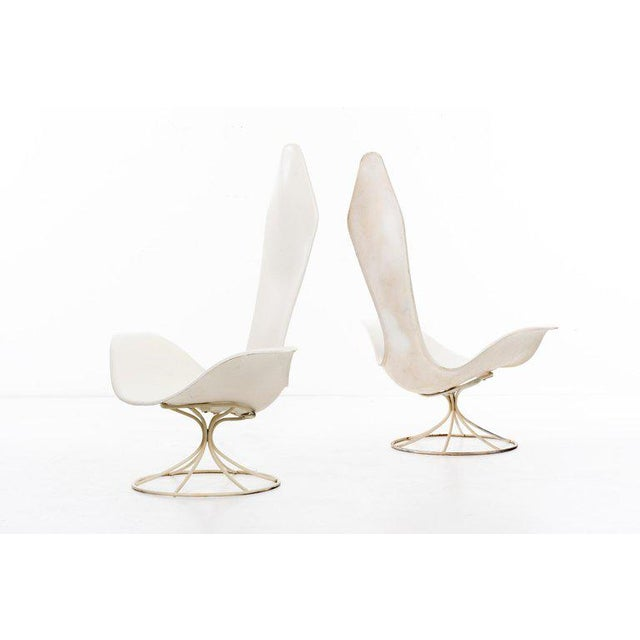 Estelle and Erwine Laverne Model no. 120-LF Tulip Chairs. Pair of high-back, flared-arm lounge chairs in molded lacquered...