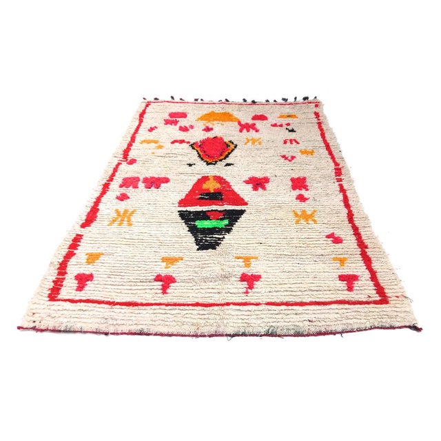 Vintage Moroccan Azilal hand woven wool rug with brightly colored abstract tribal design in bright pink, yellow green and...