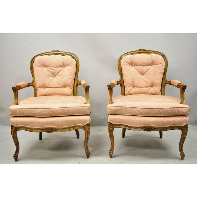 French Louis XV Provincial Style Carved Walnut Cane Back Arm Chairs - a Pair. Item features cane backs, solid wood frame,...