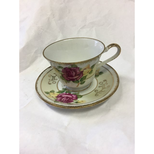 A lovely set of cup and saucer by Norleans Japan. Gold trim with roses in red and yellow. A great accent piece.