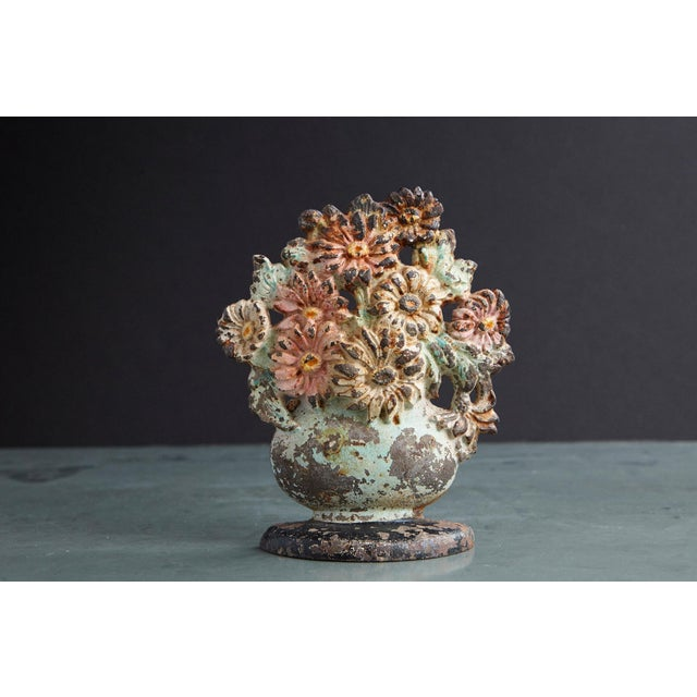 Lovely late 19th century cast iron hand painted polychrome flower bouquet in vase doorstop with it's original paint and...