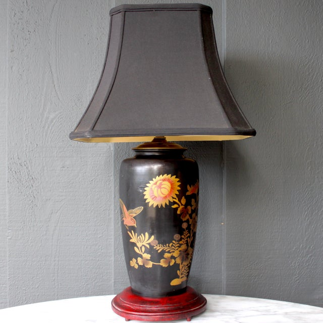 Antique Japanese lamp. Very substantial and heavy metal body, enameled in black with painted bird and floral design....