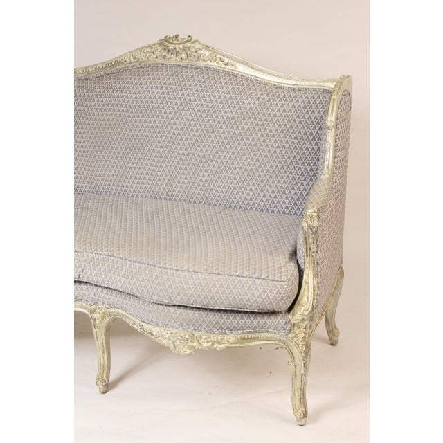 Louis XV style silver leafed and painted settee / sofa, circa 1980's. This settee has a deep seat and is comfortable to...
