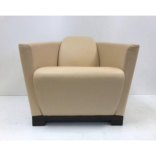 Pair modern Italian leather club chairs by Calia. Has a dark walnut stained, solid wood base. Art Deco style.