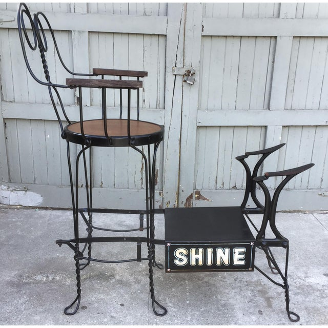 """Antique twisted iron shoe shine stand by the Royal Products Co. of Chicago. 22""""x37""""x43.5""""h. Made between 1904 and 1920...."""