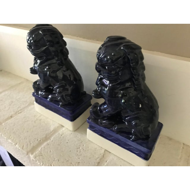 Very cool pair of dark blue foo dogs! These foo dog castings are in good vintage condition with only one spot where the...