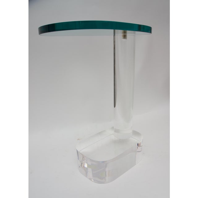 This stylish and chic side table dates to the 1970s and was produced by the Pace Furniture Company. Note: Lucite base is...