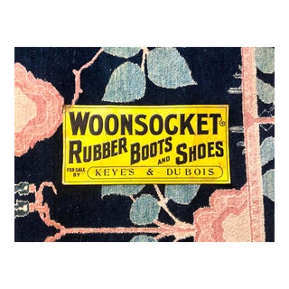 Antique Woonsocket Rubber Boots & Shoes Embossed Tin Sign For Sale
