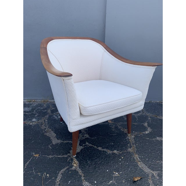 This gorgeous, rare mid century modern lounge chair is by Peter Hvidt and Orla Mølgaard and was imported for John Stuart....