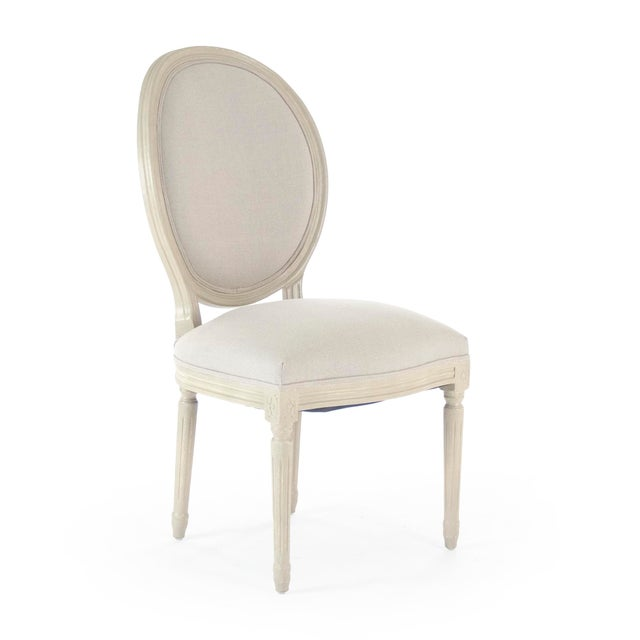 Round back side chair upholstered in natural linen on grey birch frame.