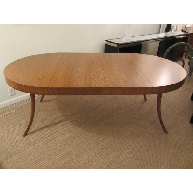 A magnificent classic walnut dining table that come with two leaves. When closed it is a perfect circle and when extended...