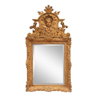 18th Century French Regence Carved Giltwood Wall Mirror With Ornate Pediment For Sale