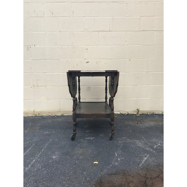 Beautiful antique tea cart, it's original condition and does have some scratches and dings. It is totally functional and...