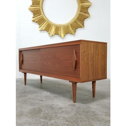 Beautiful very sturdy solid wood mid century modern credenza style. Mint condition. Sturdy. These are newer pieces....