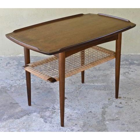 "Classic Mid-Century Scandinavian modern design illustrated by this beautiful walnut side table by the creator of the ""Z""..."