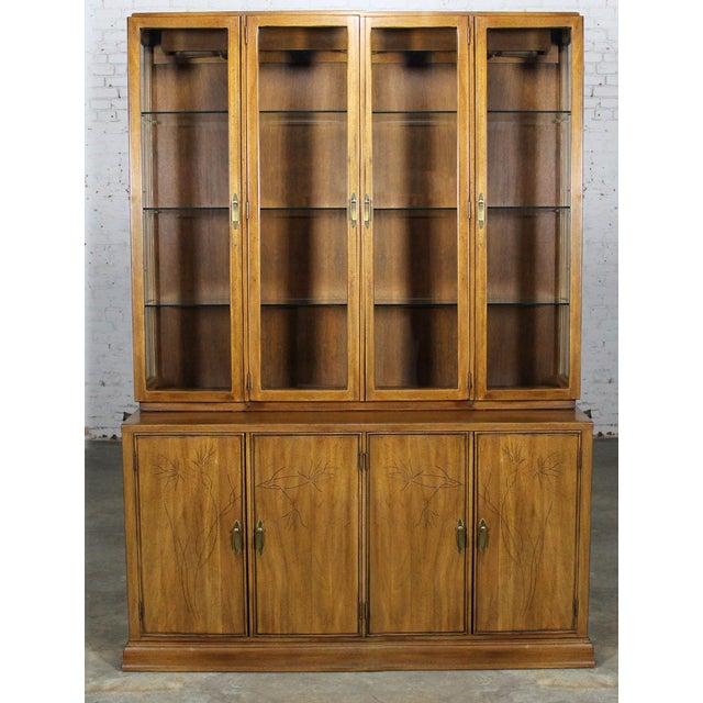 Sophisticated and stylish mid-century-modern display cabinet by Davis Cabinet Company. Made of solid mahogany with an...