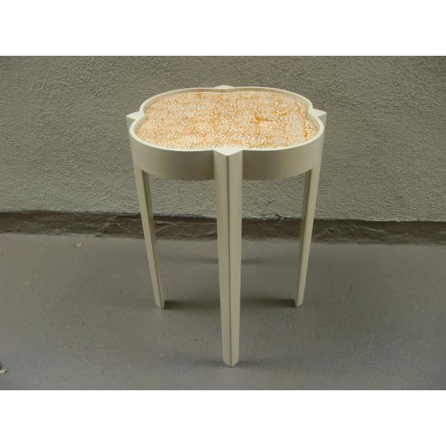 Wonderfully stylish lacquered side table with painted mosaic design painted on the top and great Moroccan silhouette.