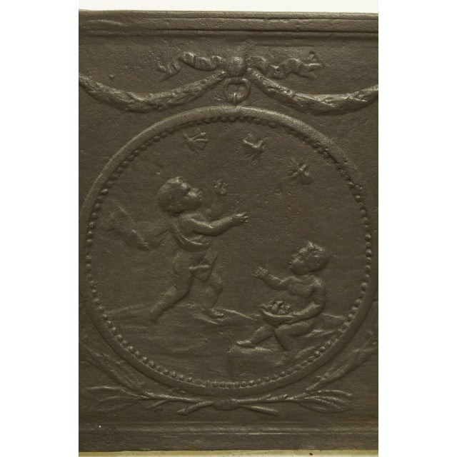 "Nice square and decorative cast iron fireback with cupids throwing ""lovebirds"". 19th century Excellent condition, to be..."