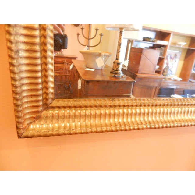 Beautiful 19th century Charles X mirror with quality gold gilding and original mercury glass.