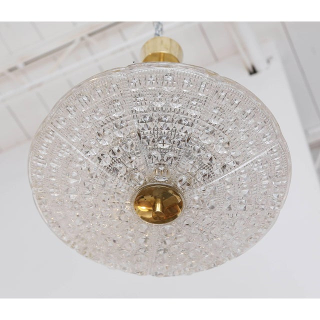 Carl Fagerlund for Orrefors bubble crystal duel disc chandelier, circa 1960s. Classic Orrefors round carved textured and...