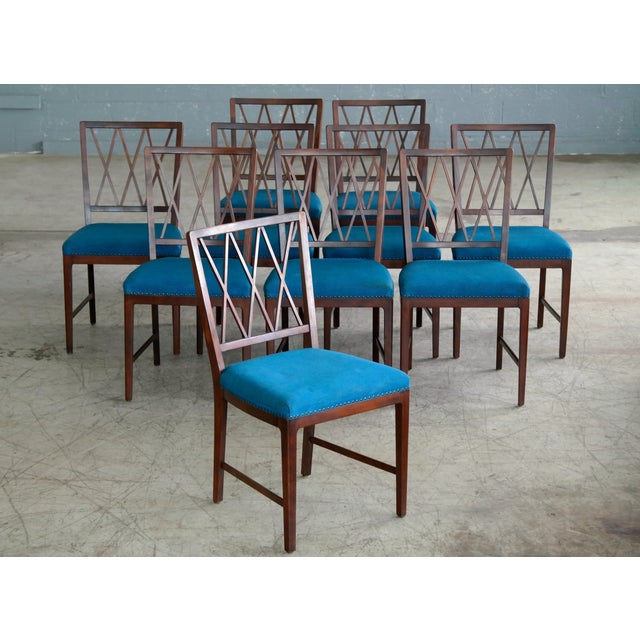 Set of 10 very elegant dining chairs in rosewood stained beech. The chairs are almost identical to Ole Wanscher's well...
