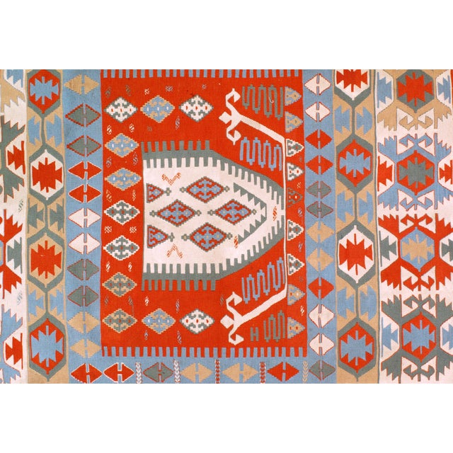 This is a vintage Turkish kilim rug from the '60s. The piece was handmade from lamb's wool. Lamb's Wool on a Wool...