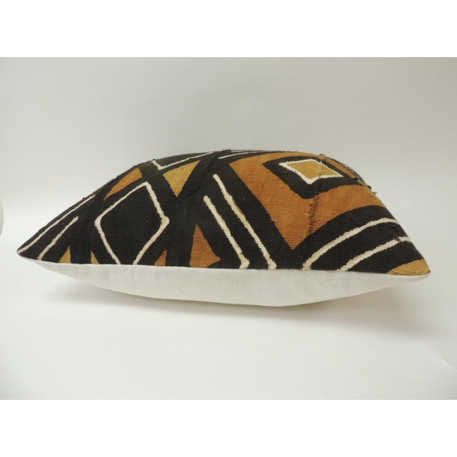 Vintage graphic African artisanal textile mud cloth decorative pillow, In shades of yellow, brown, black and natural linen...