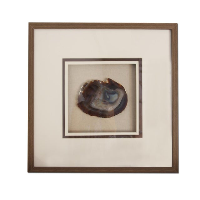 Beautifully framed sliced Agate stone displayed in quality sturdy box matted frame. Agate is historically known as the...