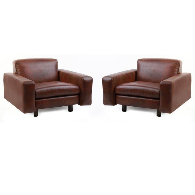 Four large scale leather and bronze lounge chairs by Metropolitan Furniture Company, circa early 1970s. These examples...