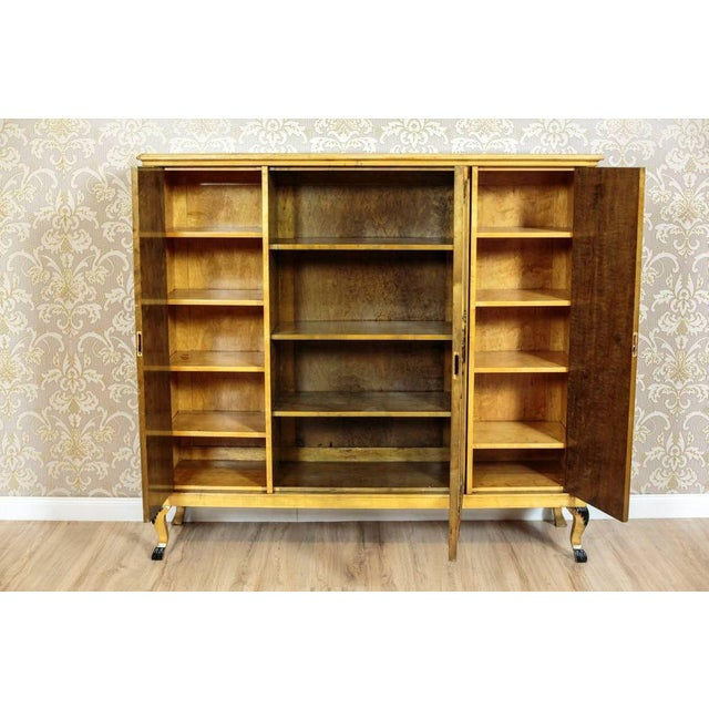 We present you a bookcase from the second half of the 20th century, veneered with birch and burl. This piece of furniture...